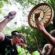 Pentacle drummers beat the beat. Thousands turned out for a march of solidarity against fracking in Balcombe. The village Balcombe in Sussex is the  centre of fracking by the company Cuadrilla. The march saw anti-fracking movements from the Lancashire and the North, Wales and other communities around the UK under threat of gas and oil exploration by fracking.