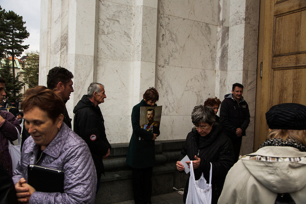 A woman holds a picture of Czar Nikolai, who was being celebrated during the visit of the Russian Orthodox patriarch to Belgrade, on the steps of Sv Sava.<br /> <br /> Joint liturgy with Serbian Orthodox and Russian Orthodox patriarchs in Sveti Sava cathedral. Belgrade, Serbia.
