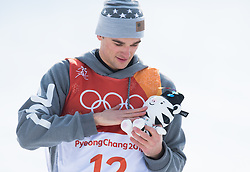 February 18, 2018 - Pyeongchang, South Korea - NICK GOEPPER of the United States pets a stuffed toy given to him on the awards stand after his silver medal finish in Mens Ski Slopestyle finals Sunday, February 18, 2018 at Phoenix Snow Park at the Pyeongchang Winter Olympic Games.  Photo by Mark Reis, ZUMA Press/The Gazette (Credit Image: © Mark Reis via ZUMA Wire)
