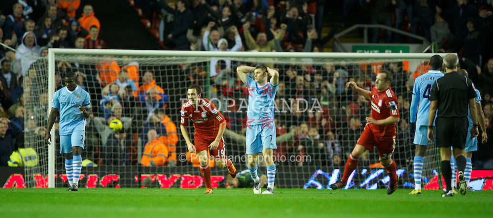 LIVERPOOL, ENGLAND - Sunday, November 27, 2011: Manchester City's Gael Clichy and James Milner look dejected as Liverpool's Charlie Adam scores the equalising 1-1 goal, after a massive deflection by Joleon Lescott, during the Premiership match at Anfield. (Pic by David Rawcliffe/Propaganda)
