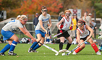 Hannah Saulnier and Cloe Boucher of Gilford and  Cheyanne Zappala and Becky Kneuer of Laconia go after control of the ball during Middle School Field Hockey action at Opechee Thursday afternoon.   (Karen Bobotas/for the Laconia Daily Sun)