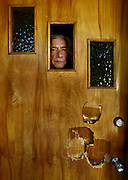 Don Dupay peers through the broken window of his front door which was recently raided by federal D.E.A. agents seeking to halt his medical marijuana operation...