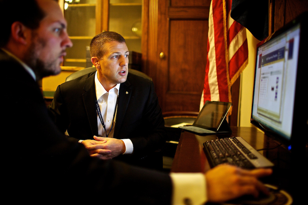 Congressman-elect Markwayne Mullin, right, from Oklahoma's 2nd District, makes decisions about his future office with his advisor Trebor Worthen, left, in the Longworth House Office Building in Washington, DC on Nov. 29, 2012.