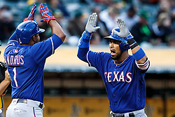OAKLAND, CA - JUNE 14:  Robinson Chirinos #61 of the Texas Rangers is congratulated by Elvis Andrus #1 after hitting a three run home run against the Oakland Athletics during the second inning at the Oakland Coliseum on June 14, 2016 in Oakland, California. (Photo by Jason O. Watson/Getty Images) *** Local Caption *** Robinson Chirinos; Elvis Andrus