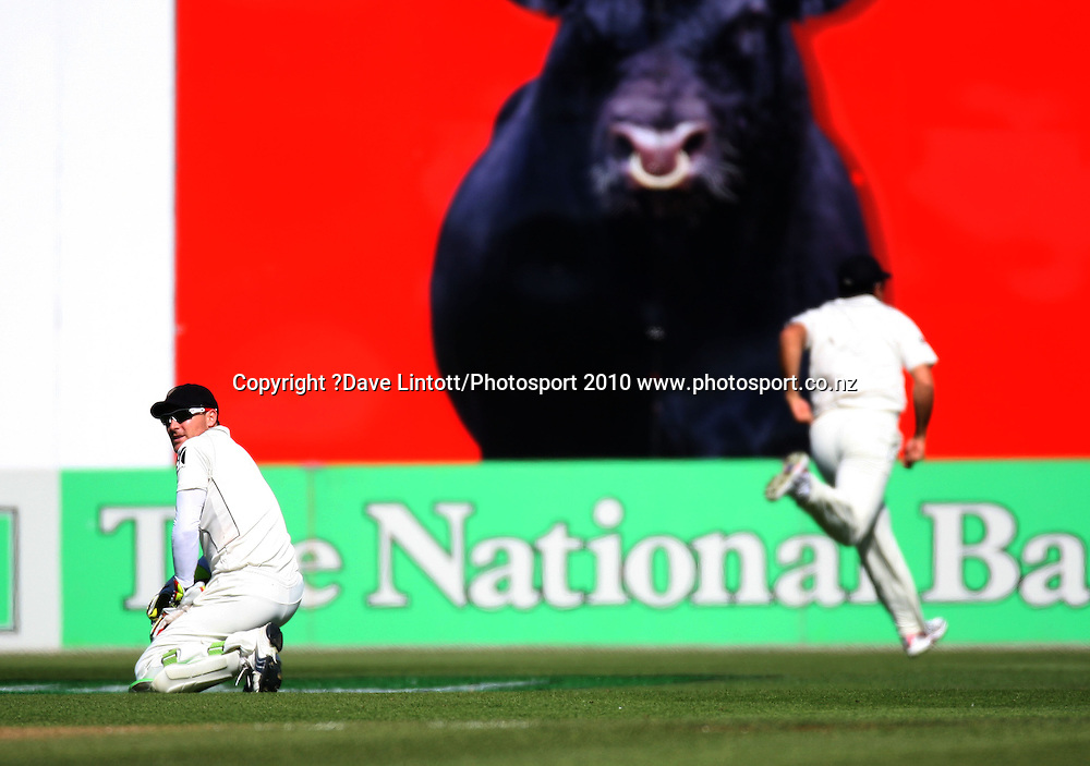 NZ keeper Brendon McCullum looks back after being beaten as Ross Taylor chases the ball to the boundary.<br /> 1st cricket test match - New Zealand Black Caps v Australia, day one at the Basin Reserve, Wellington.Friday, 19 March 2010. Photo: Dave Lintott/PHOTOSPORT
