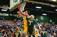 Vermont's Anthony Lamb (3) leaps over Lyndon's Eric Vargas (2) to grab the rebound during the men's basketball game between the Lyndon State Hornets and the Vermont Catamounts at Patrick Gym on Saturday afternoon November 19, 2016 in Burlington (BRIAN JENKINS/for the FREE PRESS)