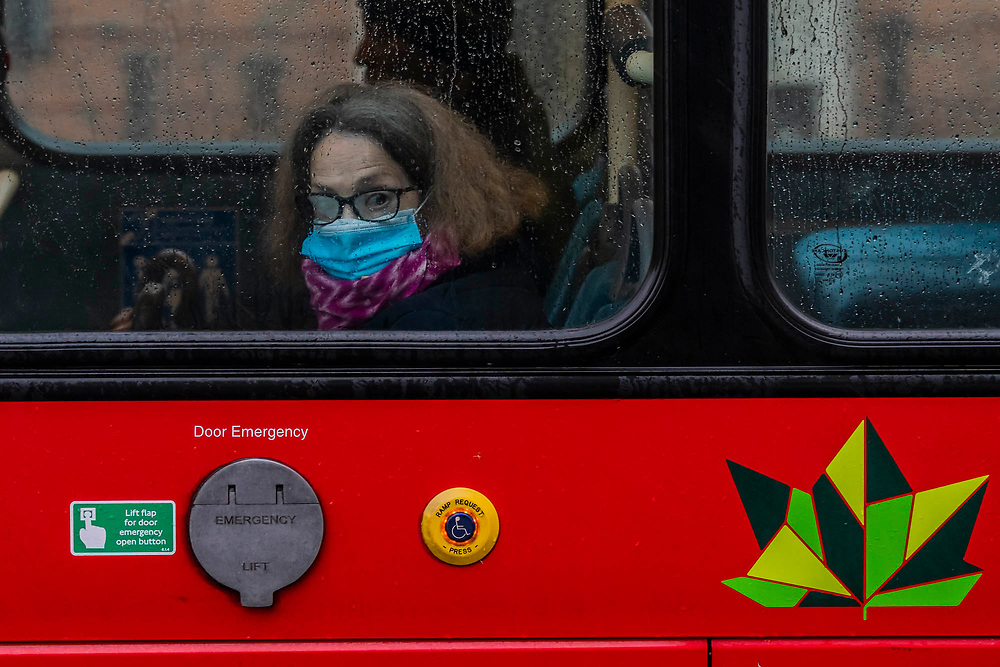 Bus travel is free and provides a brief respite from the weather - The first heavy rain doesn't stop, but greatly reduces, outdoor activity around Clapham Common. The 'lockdown' continues for the Coronavirus (Covid 19) outbreak in London.
