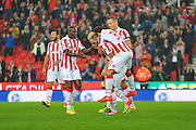 Stoke City forward Marko Arnautovic  celebrates with his team mats after scoring a goal during the EFL Cup match between Stoke City and Hull City at the Britannia Stadium, Stoke-on-Trent, England on 21 September 2016. Photo by John Marfleet.