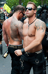 Two bare chested men at the Christopher Street Day Parade in Berlin Germany 2011