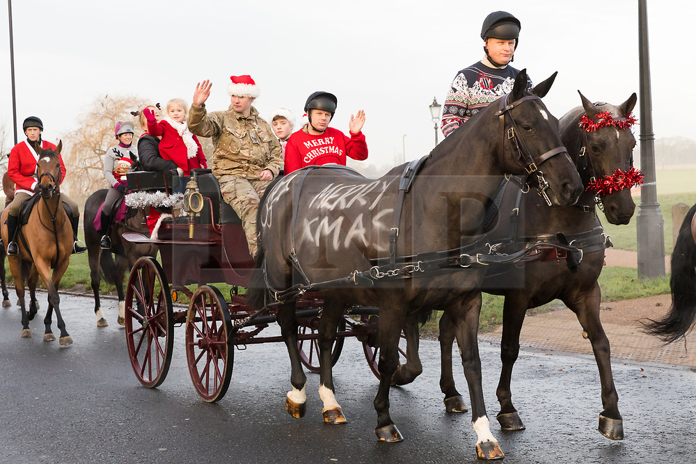 © Licensed to London News Pictures. 24/12/2018. London, UK.  Soldiers from the King's Troop Royal Horse Artillery dressed up in Christmas outfits for a traditional Christmas Eve trot through south east London this morning from their barracks in Woolwich, to Blackheath.  Photo credit: Vickie Flores/LNP