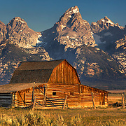 Moulton barn, part of an old homestead along what's now called Mormon Row, basks in the morning's first light in Grand Teton National Park.