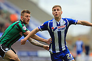 Ashley Eastham, Ryan Colclough during the Sky Bet League 1 match between Wigan Athletic and Rochdale at the DW Stadium, Wigan, England on 28 March 2016. Photo by Daniel Youngs.