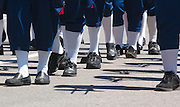 Shadows and shoes hit the pavement as the first marching band makes its way up Central Ave. during the Memorial Weekend Grand Parade in Mackinaw City, Michigan.