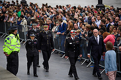 © Licensed to London News Pictures. 05/06/2017. London, UK. Members of the Met Police force including Commissioner of the Metropolitan Police CRESSIDA DICK (left)  attend a vigil at Potters Fields Park outside City Hall in London for those who lost their lives in the London Bridge terror attack. Three men attacked members of the public  after a white van rammed pedestrians on London Bridge. Ten people including the three suspected attackers were killed and 48 injured in the attack. Photo credit: Ben Cawthra/LNP