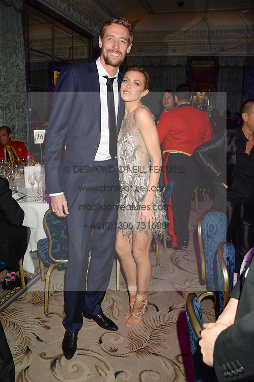 PETER CROUCH and ABBEY CLANCY at Fashion For The Brave at The Dorchester, Park Lane, London on 8th November 2013.