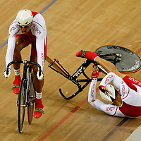 Poland's cyclist Lukasz Kwiatkowski (R) and his teamates Kamil Kuczynski in action during track cycling men's team sprint at the Beijing 2008 Olympic Games in Beijing, China, 15 August 2008.
