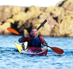 Scottish Sun sports editor Iain King takes part in a practise session for his charity kayak challenge, arriving back in the waters of the harbour at St Abbs..Pic © Michael Schofield...