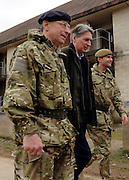 © Licensed to London News Pictures. 09/03/2012. Copedown Hill, UK. Left to right David Richards, Chief of Defence Staff and Secretary of Defence Philip Hammond visit troops during the day. The 12th Mechanized Brigade (12 Mech Bde) at Copehill Down, Salisbury Plain Training Area, Wiltshire, on FRIDAY 09 MARCH 2012, as it prepares to deploy to Helmand Province, Afghanistan, on Operation Herrick 16, in the Spring of this year. The Brigade were performing a dynamic demonstration of combined Afghan/ISAF operations supported by surveillance assets and casualty evacuation capability. Tornado GR4 fast jest ground support was also displayed.. Photo credit : Stephen SImpson/LNP