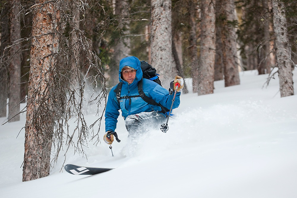 Sterling Roop skis deep powder in trees below Hayden Peak, San Juan Mountains, Colorado.