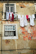 Clothes hanging at old building at Alfama