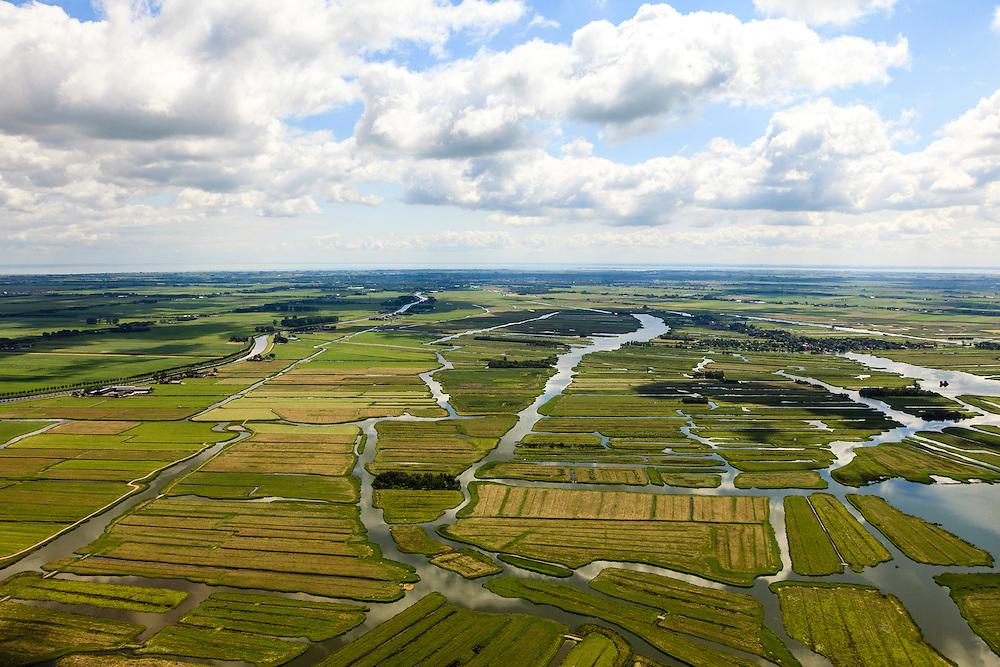 Nederland, Noord-Holland, Gemeente Wormerland, 14-06-2012; Polder Wormer, Jisp en Nek. De onregelmatige verkaveling in het gebied is het resultaat van veenontginning en vormt een  contra's met de geometrische vlakverdeling van de droogmakerij de Beemster (links). Aan het water van 't Zwet het dorp Jisp. Purmerend en IJsselmeer aan de horizon..Polder in provincie North Holland (above Amsterdam) with villages. The division in plots in the area is the result of peat extraction and forms a contrast with the geometrical division of polder Beemster left..luchtfoto (toeslag), aerial photo (additional fee required);.copyright foto/photo Siebe Swart