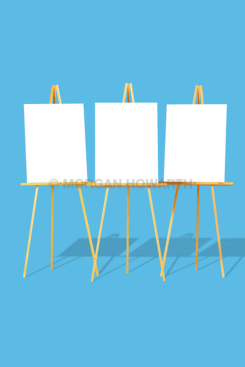 easel,easels,display,three,3, Three blank easels in a row