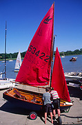 AT5BY9 Girl and boy twins with their Mirror dinghy sailing boat