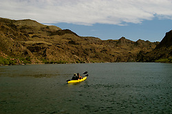 Kayaking, no model release, on the Colorado River below Hoover Dam on border of Arizona, AZ, Nevada, NV, tourism, vacation, sports, action, landscape, image nv422-18497.Photo copyright: Lee Foster, www.fostertravel.com, lee@fostertravel.com, 510-549-2202