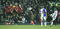 Photo: Aidan Ellis.<br /> Blackburn v Manchester United. Barclays Premiership. 01/02/2006.<br /> Blackburn's Morten Gamst Pedersen floats in the free kick for David Bentley to score the second goal