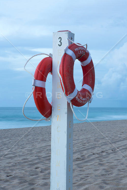 two lifesavers on a post at the beach in Florida