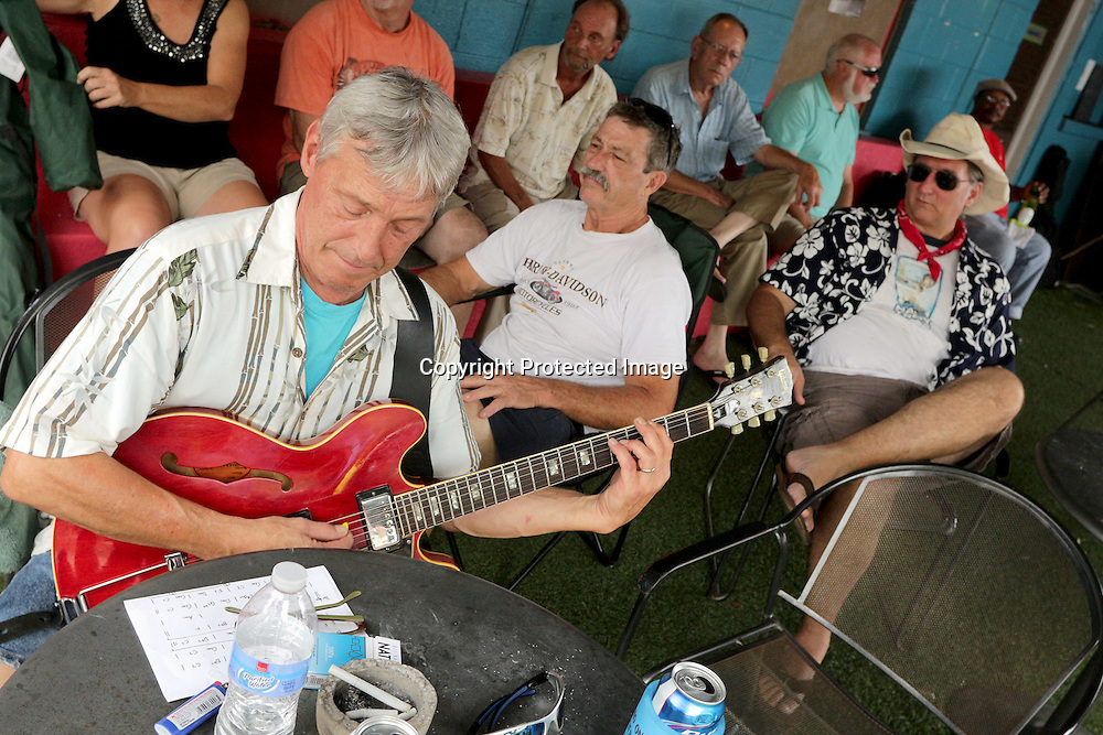 Jim Varno warms up before performing Sunday July 27, 2014 during the All-Day Blues Jam at The Rusty Nail in Wilmington, N.C. The event was part of the 19th Annual Cape Fear Blues Festival. (Jason A. Frizzelle)