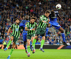 Sammy Ameobi of Cardiff City and Dannie Bulman of AFC Wimbledon compete for a high ball - Mandatory by-line: Paul Knight/JMP - Mobile: 07966 386802 - 11/08/2015 -  FOOTBALL - Cardiff City Stadium - Cardiff, Wales -  Cardiff City v AFC Wimbledon - Capital One Cup