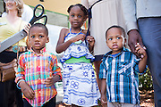 Party Fever owner Mubedi Kaninda's children, from left to right, Leo Alexandre, 3, Marie-Antoinette, 6, and Charles Aiden, 2, participate in the Milpitas Chamber of Commerce Ribbon Cutting Ceremony at Party Fever in Milpitas, California, on July 31, 2014. (Stan Olszewski/SOSKIphoto)