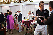 Dr. Lachlan Strahan (in white hat) of the Australian High Commission and Princess Diya Kumari of Jaipur (on Dr. Strahan's right) mingle with other guests at the high tea event after the Argyle Pink Diamond Cup, organised as part of the 2013 Oz Fest in the Rajasthan Polo Club grounds in Jaipur, Rajasthan, India on 10th January 2013. Photo by Suzanne Lee