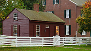 Shaker Village workshop with white fence