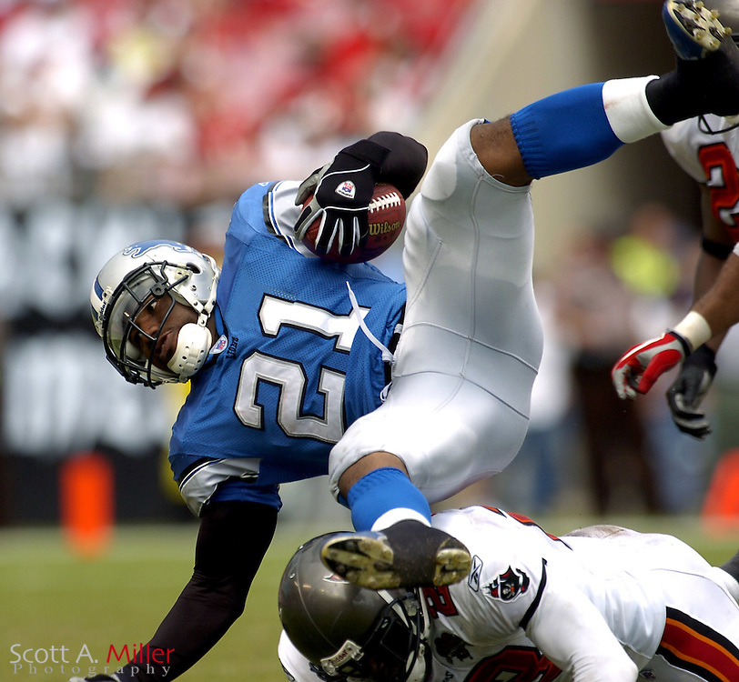 Oct. 5, 2005; Tampa, FL, USA;  Detroit Lions running back #21 Artose Pinner is tripped up during the second half of the Lions game against the Tampa Bay Buccaneers at Raymond James Stadium.  The Bucs won the game 17-13.          ©2005 Scott A. Miller..©2005 Scott A. Miller