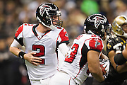 NEW ORLEANS, LA - DECEMBER 26:   Matt Ryan #2 of the Atlanta Falcons makes a hand off to Michael Turner #33 during a game against the New Orleans Saints at Mercedes-Benz Superdome on December 26, 2011 in New Orleans, Louisiana.  The Saints defeated the Falcons 45-16.  (Photo by Wesley Hitt/Getty Images) *** Local Caption *** Matt Ryan; Michael Turner