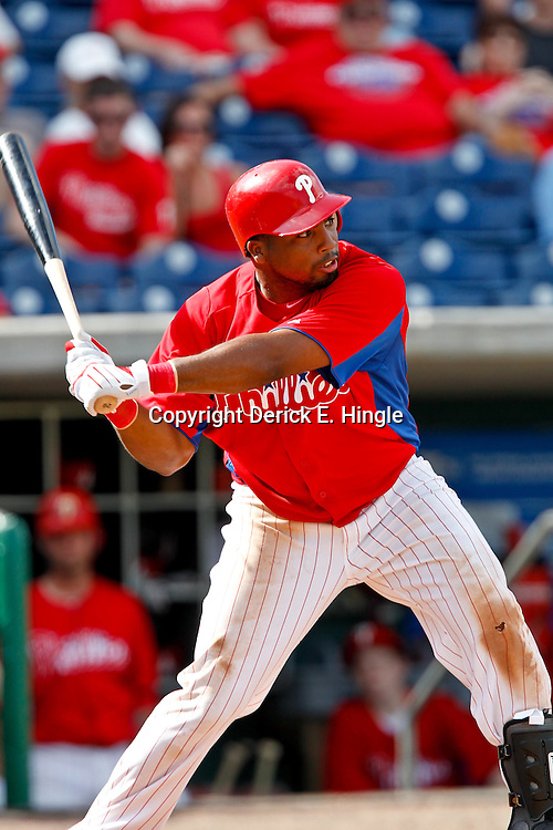 February 29, 2012; Clearwater, FL, USA; Philadelphia Phillies second baseman Hector Luna (29) hits a homerun during a spring training exhibition game against Florida State University at Bright House Networks Field. The Phillies defeated Florida State 6-1. Mandatory Credit: Derick E. Hingle-US PRESSWIRE