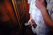 Man using his mobile phone in the toilets at Inertia Derry Northern Ireland March 2002