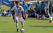 Team USA defender John Cortez (4) dribbles the ball during a CONCACAF boys under-15 championship soccer game, Sunday, Aug. 4, 2019, in Bradenton, Fla. The USA defeated Haiti 2-0 (Kim Hukari/Image of Sport)