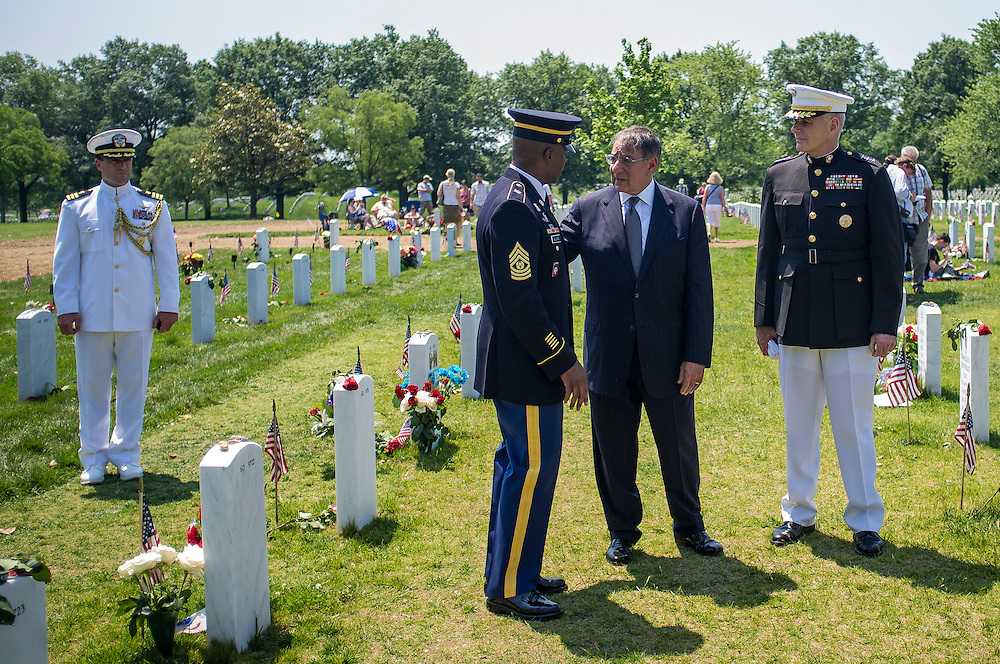 Secretary of Defense Leon Panetta visits with the families and military personel on Memorial Day at Arlington National Cemetery in Arlington, VA, USA on 28 May, 2012. Arthur Campbell, his wife Audrey and Devin Campbell were visting the gravesite.