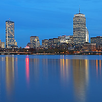 Boston Blue Hour photography featuring familiar landmarks along the Charles River, Prudential Center and 200 Clarendon better known as the John Hancock Tower. This Boston skyline photography image at twilight is available as museum quality photography prints, canvas prints, acrylic prints or metal prints. Fine art prints may be framed and matted to the individual liking and decorating needs:<br />