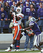 Oklahoma State wide receiver Rashaun Woods (82) pulls in a touchdown pass over Kansas State's Terence Newman (R) at KSU Stadium in Manhattan, Kansas in 2002.