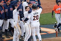 Virginia Cavaliers outfielder Brandon Guyer (20) is congratulated by his team after hitting a two run home run against Duke.  The Virginia Cavaliers Baseball team fell to the Duke Blue Devils 13-9 in the second of a three game series at Davenport Field in Charlottesville, VA on April 7, 2007.