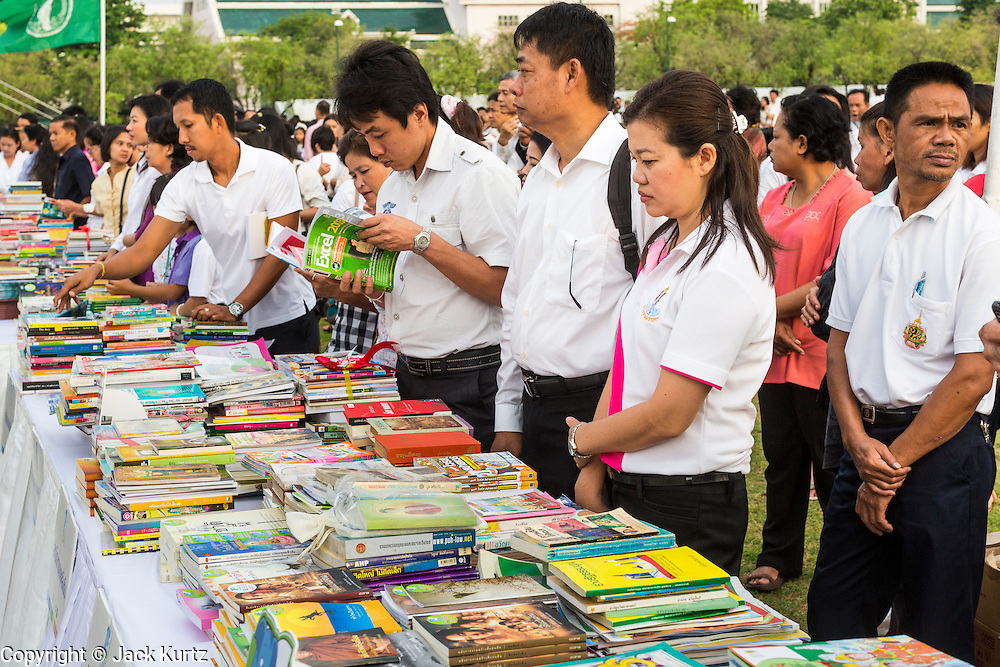 "23 APRIL 2013 - BANGKOK, THAILAND:   Thais browse among the books being donated to Thai literacy projects during the opening ceremony to mark Bangkok as the World Book Capital City 2013. UNESCO awarded Bangkok the title. Bangkok is the 13th city to assume the title of ""World Book Capital"", taking over from Yerevan, Armenia. Bangkok Governor Suhumbhand Paribatra announced plans that the Bangkok Metropolitan Administration (BMA) intends to encourage reading among Thais. The BMA runs 37 public libraries in the city and has modernised 14 of them. It plans to build 10 more public libraries every year. Port Harcourt, Nigeria will be the next World Book Capital in 2014.<br /> PHOTO BY JACK KURTZ"