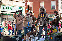 The Laconia Sled Dog float heads up Main Street during the annual Holiday parade on Saturday morning.  (Karen Bobotas/for the Laconia Daily Sun)