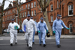 © Licensed to London News Pictures. 08/03/2019. Fulham, London, UK. Forensic team approachs Lanfrey Place where 17yr old Ayub Hassan died of stab wounds sustained in an attack yesterday afternoon. Four teenagers have been arrested in connection with the murder, the investigation continues. Photo credit: Guilhem Baker/LNP