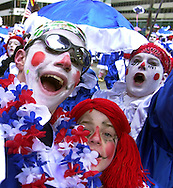 PHILADELPHIA - JANUARY 4: Members of the wench division, dressed as Raggedy Ann, rush towards the judging stand to perform during the 102nd Annual New Years Day Mummers Parade, January 4, 2003, in Philadelphia, Pennsylvania. The parade was postponed because of rain on New Years Day, the first time since 1990, and the 15th time in 40 years that the parade was postponed.  (Photo by William Thomas Cain/Getty Images)
