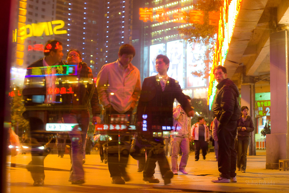 People enjoy night life in Chongqing, China, March 4, 2009.