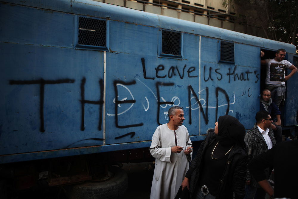 Graffiti on a armored police van destroyed during protests on 28 January 2011.